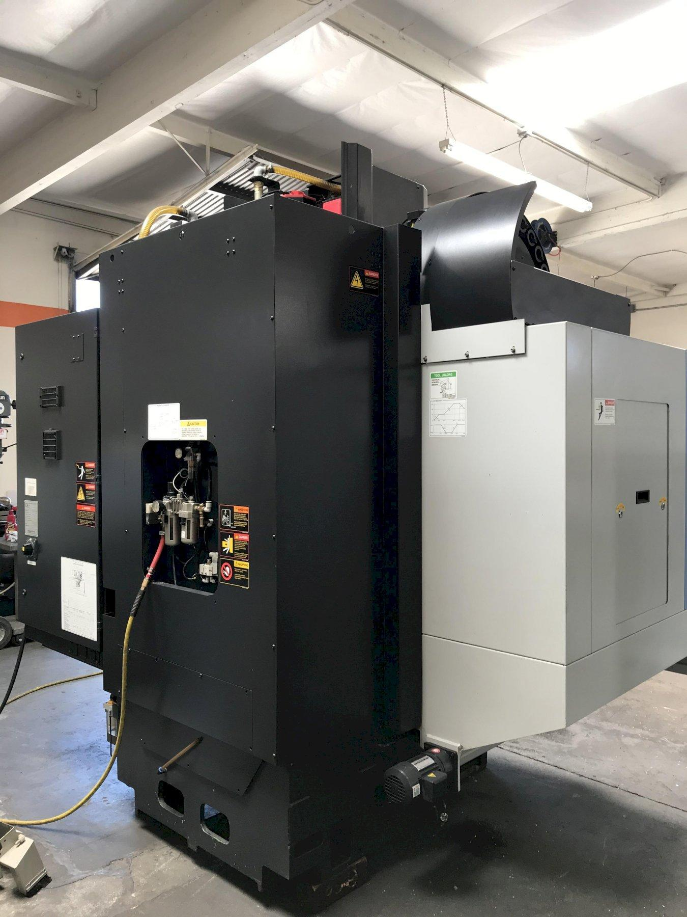 "Doosan DNM400 VMC 2010, Fanuc I Series Control, 30"" x 17"" x 20"" Travels, 8k RPM 20-HP Spindle, 30-ATC, Chip Conveyor, and Coolant Tank."