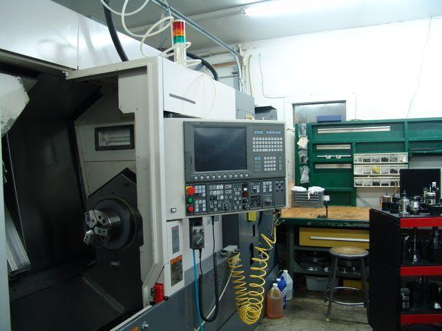 "Okuma Multus B300W, Okuma OSP P200L CNC, 10"" Chuck On Main Spindle, 8"" Chuck on Sub-Spindle. Universal Milling/Turning Head, 40 Station Tool Changer, New 2009."