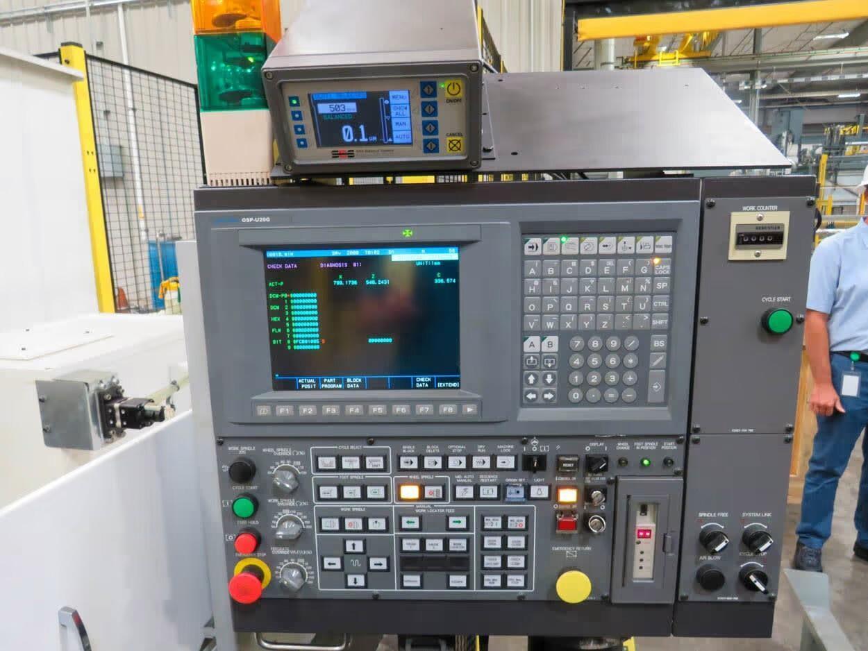 "OKUMA GP-57N CNC PLAIN CYLINDRICAL GRINDER, OSPU20G CNC Control, 23"" Swing, 124"" Between Centers, 30"" x 5"" Grinding Wheel, 20"" Rota-NCO 3-Jaw Chuck, Motorized Tailstock, Schmitt Model SB-5500 SBS Balance System, Sumitomo Model FP-18B-1 Fabric Filtration System,  New 2015. * Test Bar still Chucked- Never used in Production- Like New"