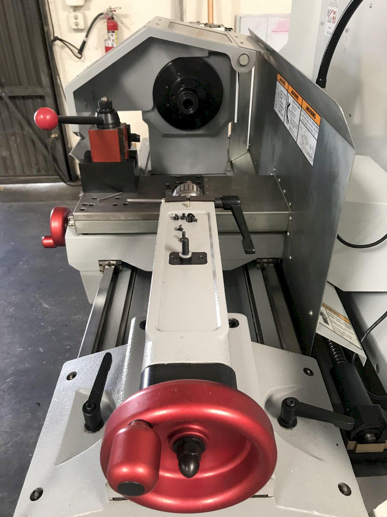 Haas TL-1 Horizontal Toolroom Lathe 2005, Splashguard, Tailstock, Tool Post, and Work Light.