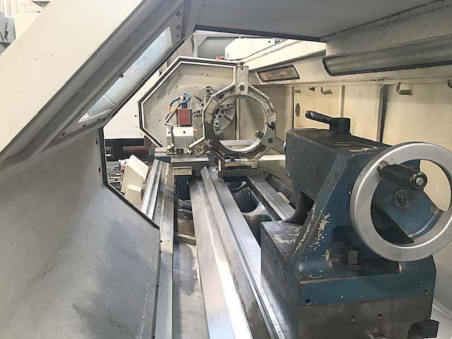 """ROMI M27, Fanuc 21i CNC, 30"""" x 120"""" CNC Flat Bed Lathe, Dual MPG for Manual Operation, Teach Function, Steady Rest, 20"""" 4-Jaw Chuck, 6"""" Spindle Bore, 30 HP, 1000 RPM, New 2004."""