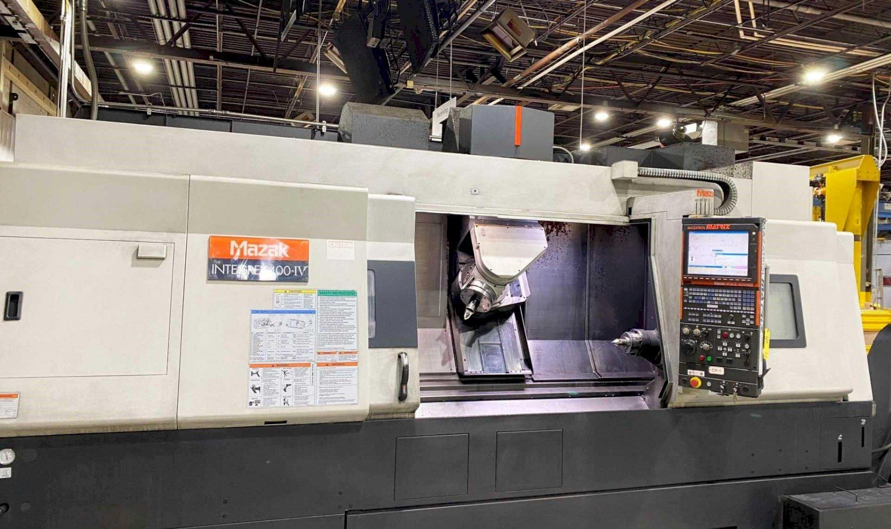 Mazak Integrex 400-IV Multi-Tasking CNC Turning Center 2007 with Mazatrol Matrix CNC Control, Live Milling, 5-Axis, Tailstock, Coolant Thru Spindle, and Chip Conveyor.