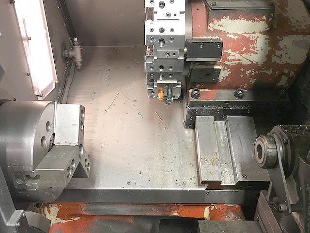 """TAKISAWA TC-200, Fanuc 21i CNC Control, 16"""" Swing, 8"""" Chuck, Tailstock with 24"""" Between Centers, 8 Position Turret, Parts Catcher, New 2002."""