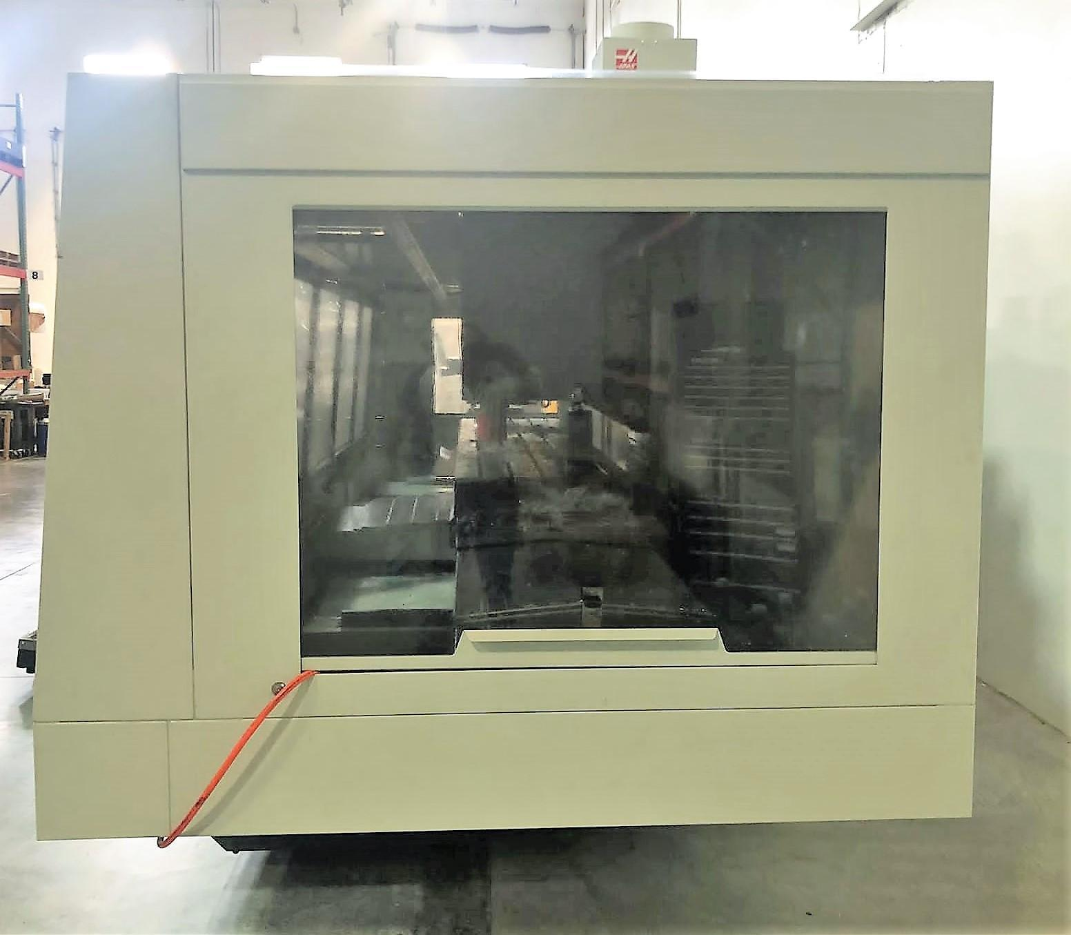 Haas VF-12/40 VMC 2019 With: 4th Axis Drive, Through Spindle Coolant, Wireless Probing System, High Speed Machining, and 32-GB Expanded Memory.