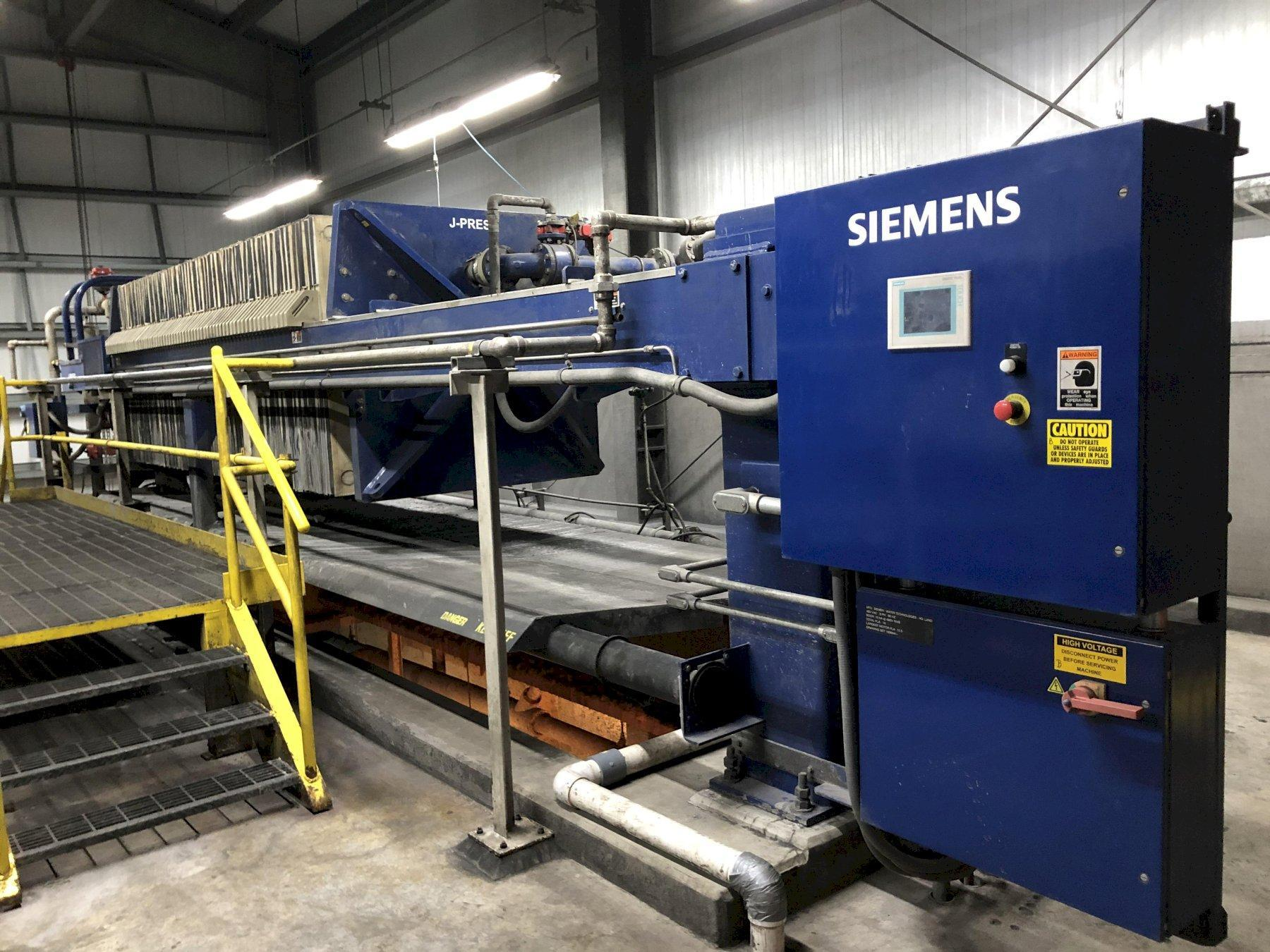 Siemens model 1500n32-64/90-125/175sylc 1500 mm filter press s/n f008177 with 65- approx. 1500 x 1500 mm filters, Siemens plc controls, side bar suspension