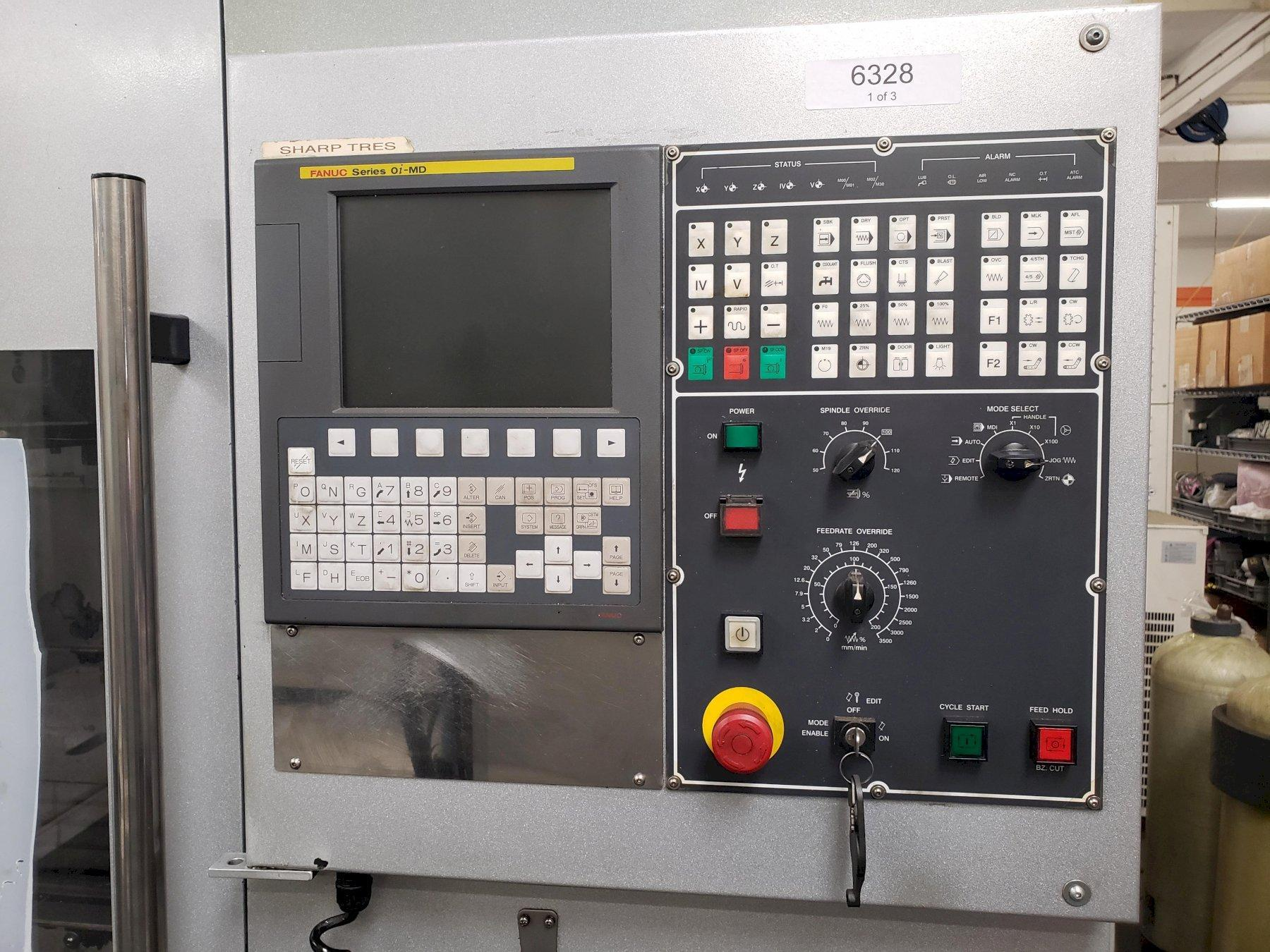 Sharp SV-2412 SX VMC 2011 with: Fanuc Oi-MD CNC Control, Side Mount Tool Changer, Chip Conveyor, and Coolant Tank.