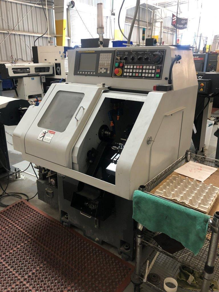 Cubic GT Mini Plus Gang Tool Lathe 2018 with: Fanuc Oi-TF CNC Control and Bar Feeder.