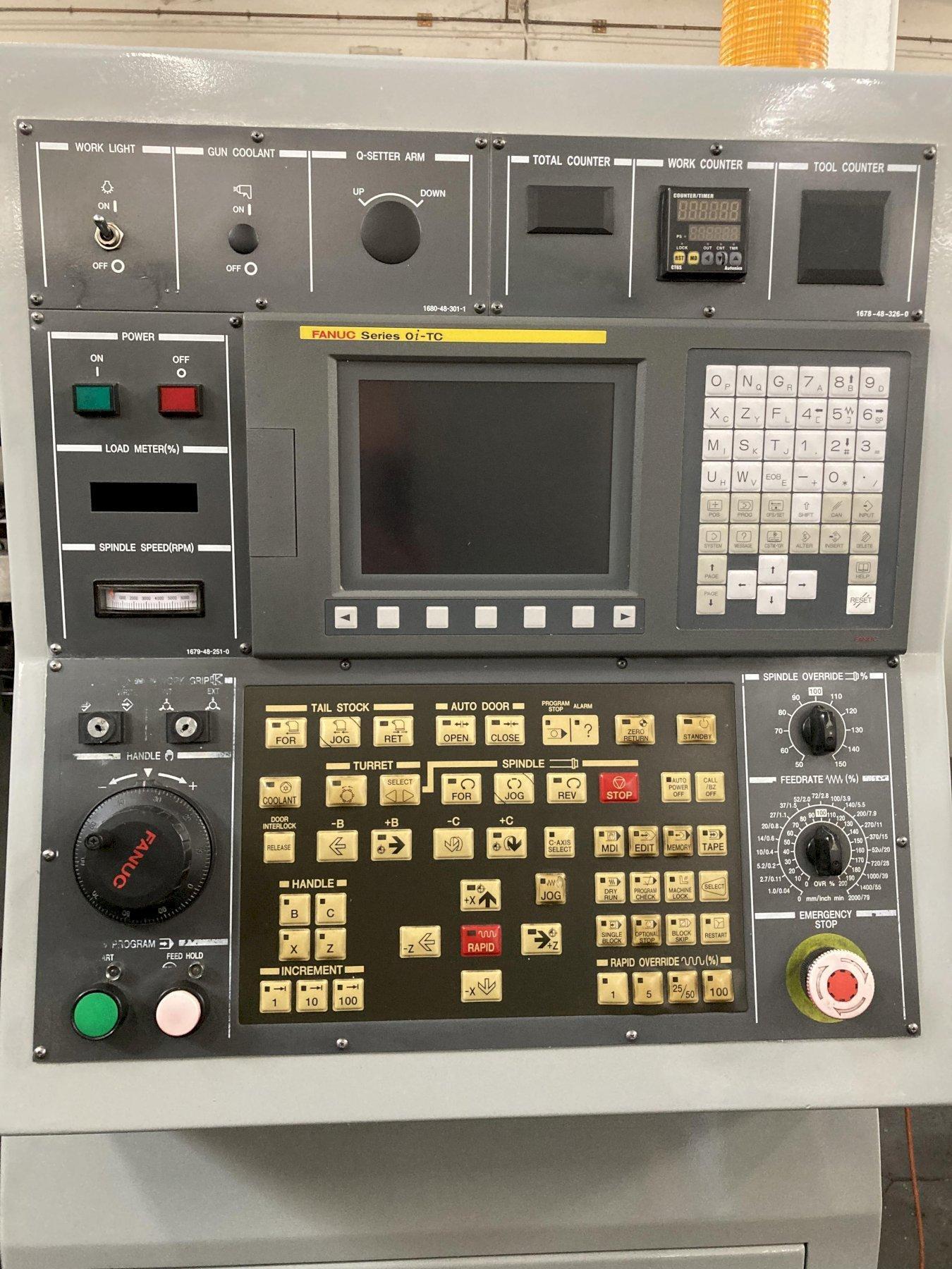 Hyundai Kia SKT-100 CNC Lathe 2006 with: Fanuc Series Oi-TC Control, Tool Presetter, and Coolant Tank.