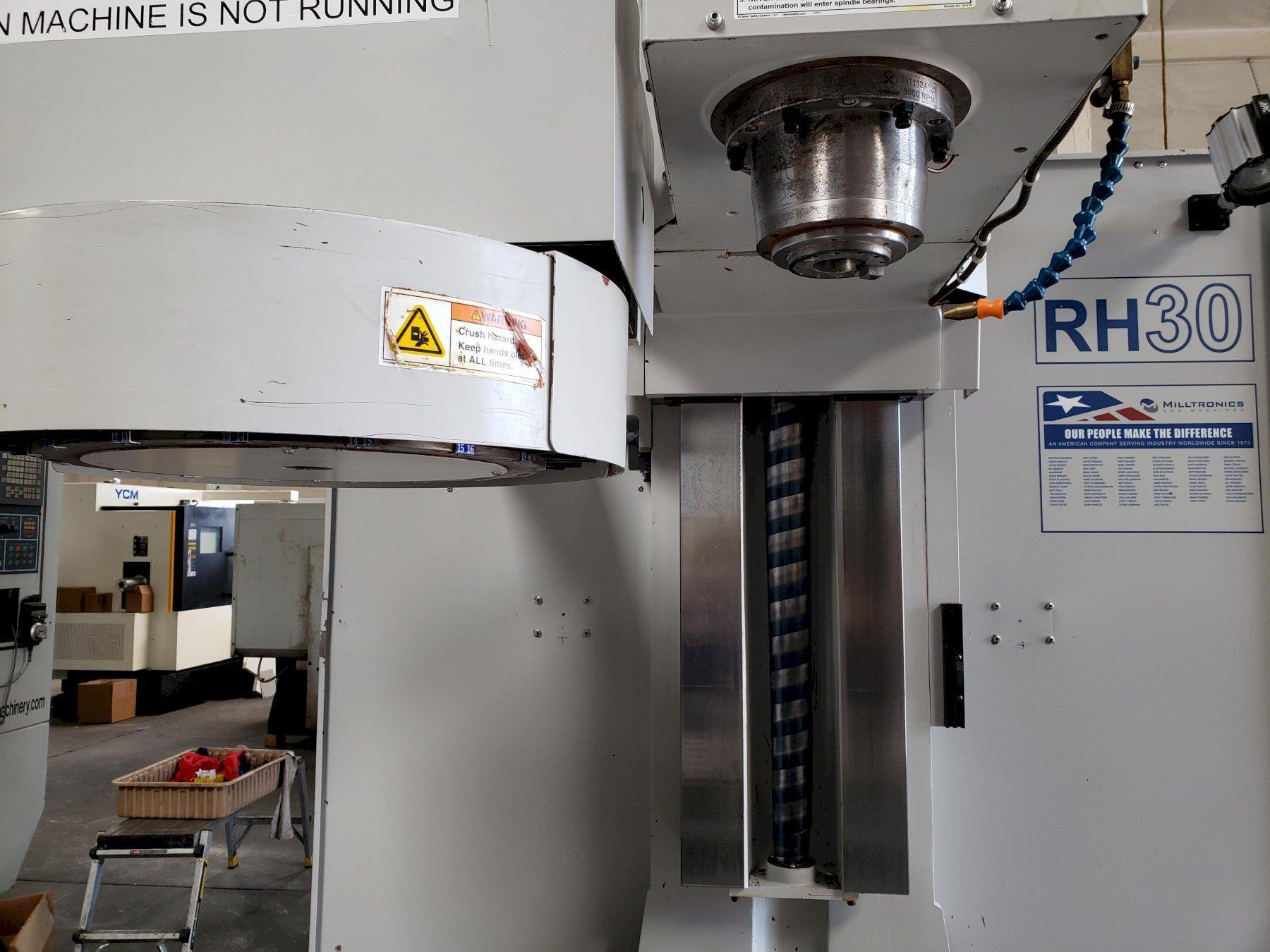 """Milltronics RH30L Toolroom Mill 2013 with: Milltronics 8200 CNC Control, 60""""x30""""x28"""" Travels, Rigid Tap, Remote Jog Handle, Rear Splash Guards, and Spray Mist Coolant."""