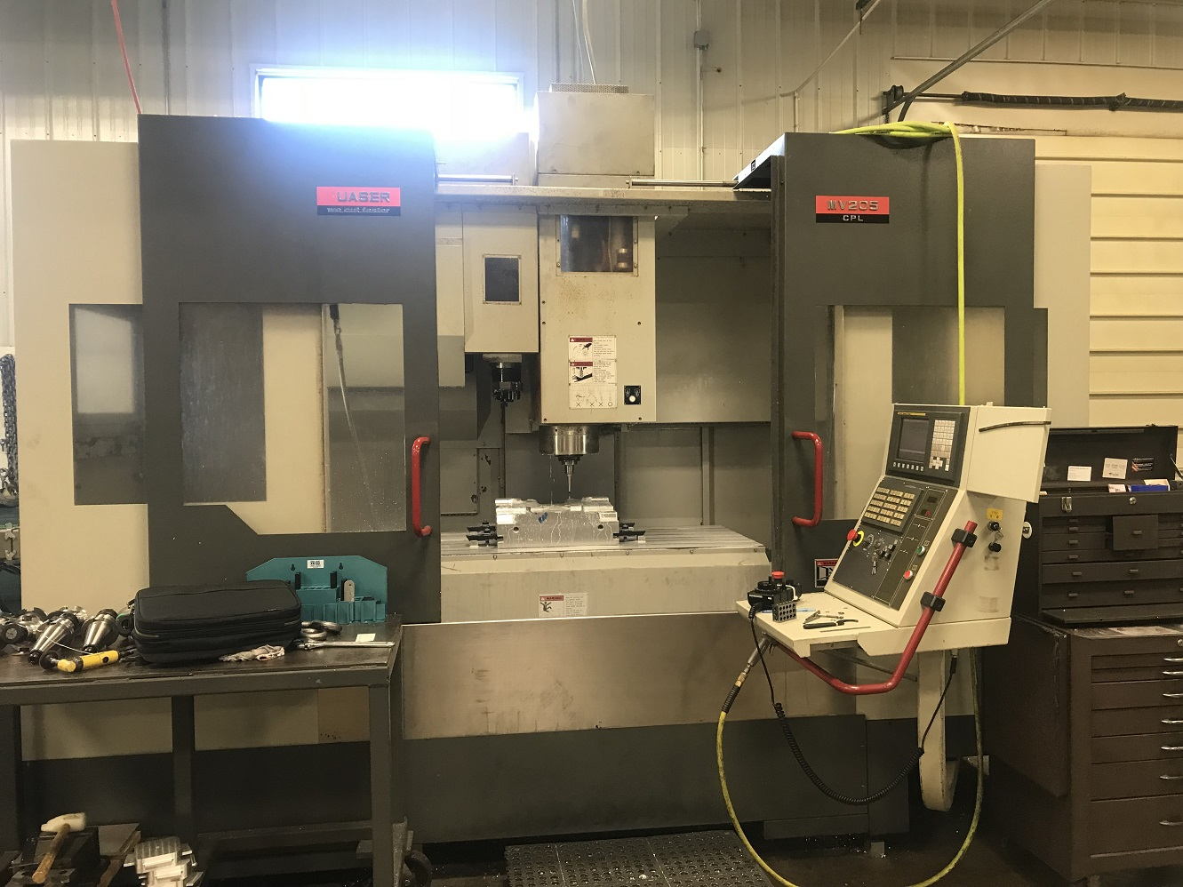 QUASER MODEL MV205 CNC VERTICAL MACHINING CENTER WITH 50 TAPER GEARED HEAD