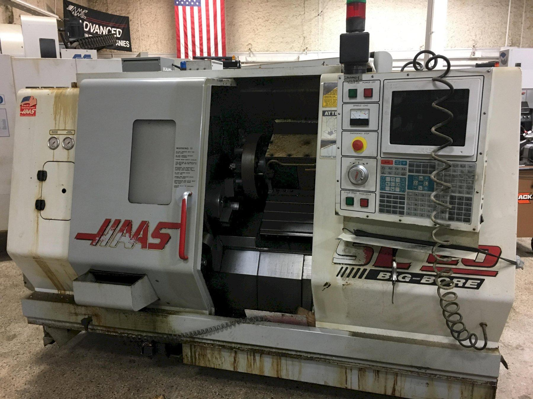 Haas SL20TB Big Bore CNC Turning Center with Haas Bar Feeder, S/N 62623, New 10/99.