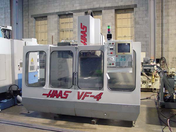 "HAAS VF-4, Haas 32-Bit CNC Control, 58"" x 18"" Table X=50"", Y=20"", Z=25"", 7500 RPM, 15 HP Geared Spindle, 20 Station Tool Changer, Rigid Tap, New 1995."