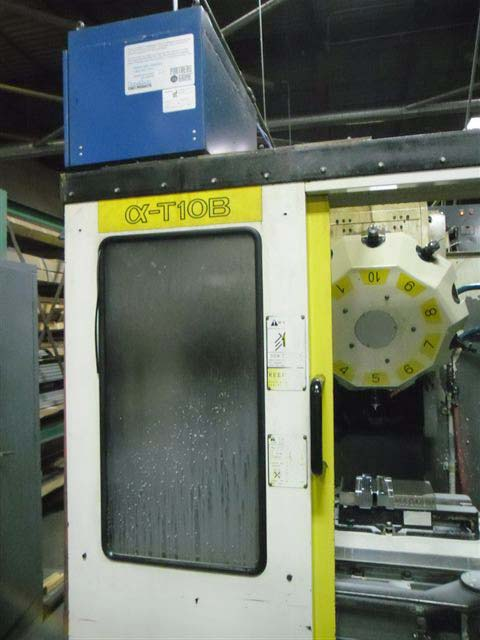 "FANUC ROBODRILL a-T10B, Fanuc 16M CNC Control, (2) 14.56"" x 25.69"" Pallets, (2) 8"" 4th Axis Rotary Tables, X=20"", Y=15"",Z=12"", 8,000 RPM, 7.5 HP, 10 Station Turret, (2) Pallets, New 1995."
