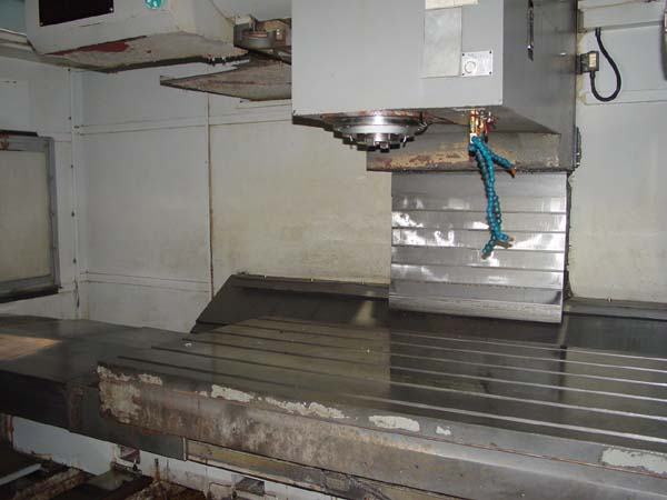 """LEADWELL MCV2200 , Fanuc 0i-MC CNC Control, 94"""" x 38"""" Table, X=86.6"""", Y=40"""", Z=31.5"""", 50 Taper, 32 Station Tool Changer, New 2007."""
