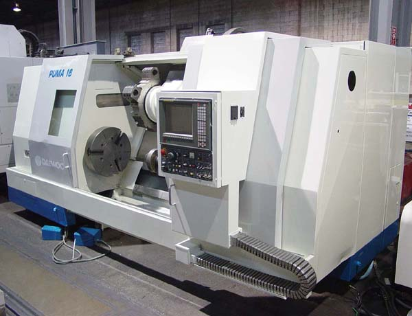 """Daewoo Puma 18S, Fanuc 18T CNC, 24"""" Chuck, 35"""" Swing, Tailstock with 62"""" Centers, 60 HP, New 1995."""