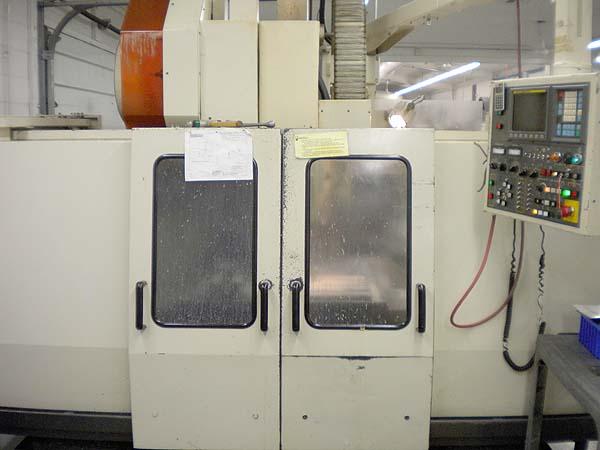 YANG MV-3A, Fanuc 0M CNC, X=30, Y=17, Z=19, 28 ATC, 6000 RPM, Cat-40, Box Ways Geared Head, New 1995.