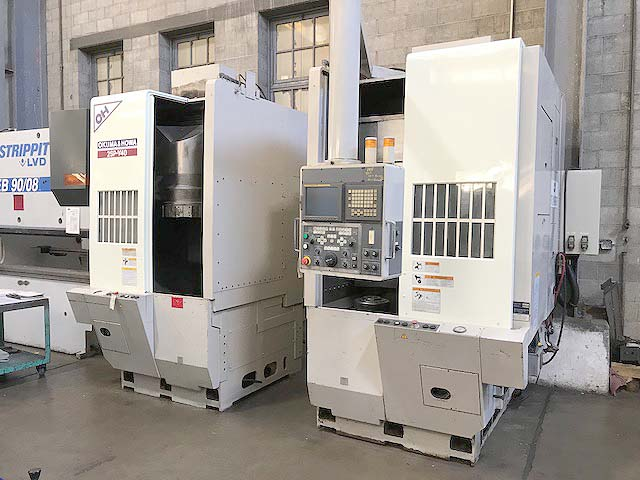 "OKUMA HOWA 2SP-V40 VERTICAL TURNING CENTER, Fanuc 18i CNC Control, 20"" Swing, 17"" Max Turning Height, (2) 28HP Spindles, New 2003."
