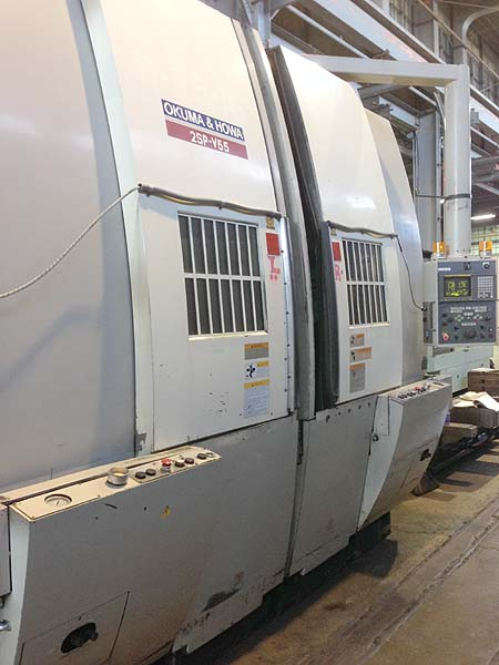 """OKUMA HOWA 2SP-V55 VERTICAL TURNING CENTER, Fanuc 18i CNC Control, Twin Spindle, 30"""" Swing, (2) 40 HP Spindles, New 1999."""