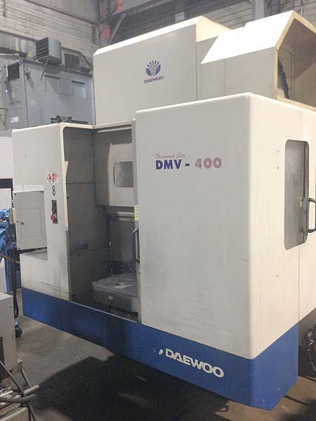 "DAEWOO DMV-400, Fanuc 18M CNC Control, (2) 21"" x 25.5"" Work Zones, X=22"", Y=15"", Z=22"", Cat-40, 10,000 RPM, Thru Spindle Coolant, New 2000."
