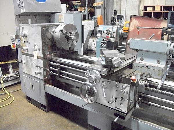 """25"""" x 120"""" TOOLMEX LATHE, Model TUR630A, 24.8"""" Swing, 15"""" Front Chuck and 15"""" Rear Chuck, 5.5"""" Thru Hole, Inch/ Threading, Taper Attachment, Steady Rest, New 1996."""