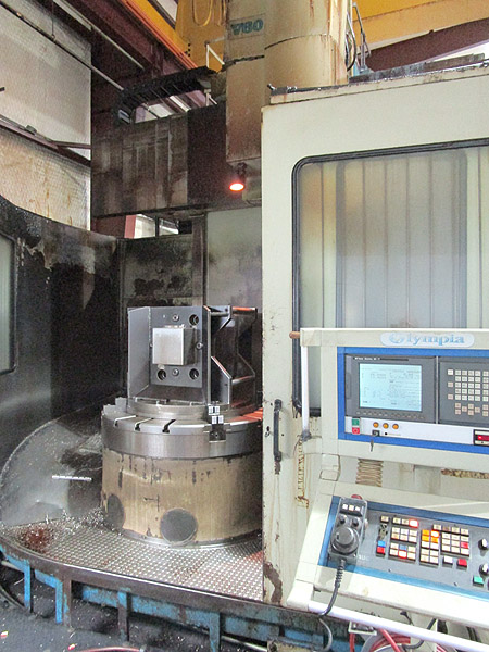 "55"" OLYMPIA CNC VERTICAL BORING MILL, Model V60VTL, Fanuc 18iTB CNC, 55"" 4 Jaw Chuck, 70.86"" Swing, 60"" Under the Ram, 67"" Under Rail, 12 Station Tool Changer, New 2001."