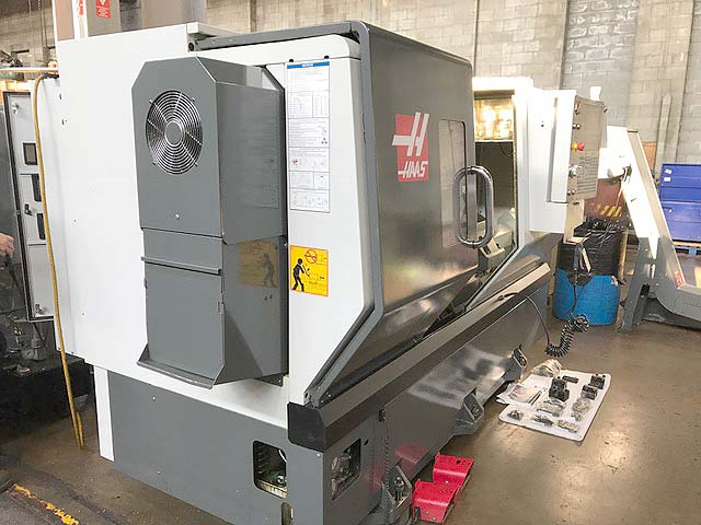 """HAAS ST-30 CNC LATHE, Haas CNC Control, 31"""" Swing, 10"""" Chuck, Programmable Tailstock with 26"""" Centers, 30 HP, Tool Eye, Conveyor, New 2012."""