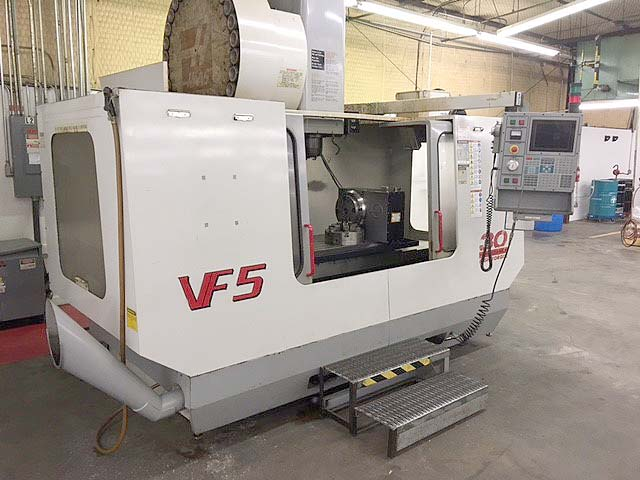 """HAAS VF-5/50 CNC VERTICAL MACHINING CENTER, Haas CNC, 52"""" x 23"""" Table, X=50"""",Y=26"""",Z=25"""",50 Taper, 7500rpm,Probes, New 2000."""