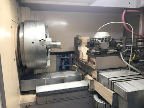 "TACCHI FTF-1600, Fanuc 0T-C CNC, 45"" Swing, 31"" Chuck, 14"" Thru Hole, Tool Turret, 100 HP, 560 RPM, Front and Rear Power Chucks, 2006."