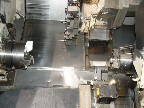 """DAEWOO PUMA TT2500SY, Fanuc 18i-TB CNC Control, Twin Spindles w/ 10"""" Chucks, Twin Turret, Live Tooling in Both Turrets, C-Axis on Both Spindles, Y-Axis Upper Turret, 2005."""