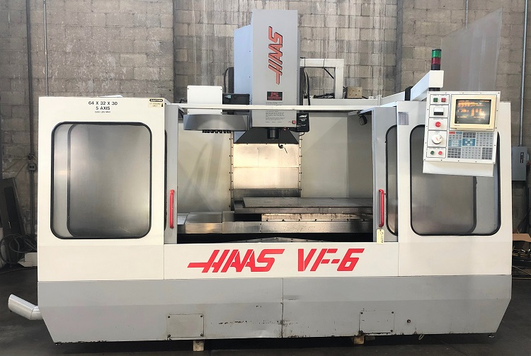 """HAAS VF-6, Haas CNC Control, 64"""" x 28"""" Table, Travels X=64"""", Y=32"""", Z=30"""", 7500 rpm, 20 Station Tool Changer, Prewired for 4th and 5th Axis, New 1995."""