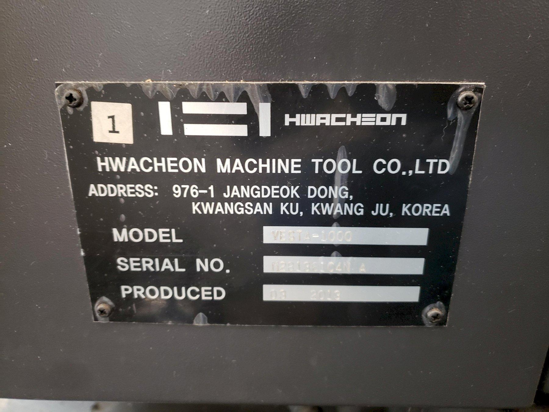 Hwacheon Vesta 1000 CNC Vertical Mill 2013, Fanuc Oi-MF CNC Control, Thru Spindle Coolant, Rigid Tapping, Chip Conveyor, and Spindle Chiller.