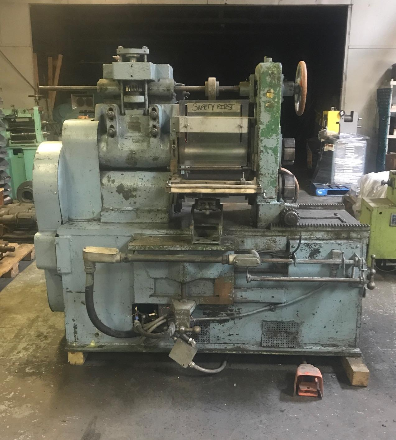 "RUESCH MODEL 146 4.250"" X 14"" SLITTER WITH SINGLE RECOILER AND TOOLING"