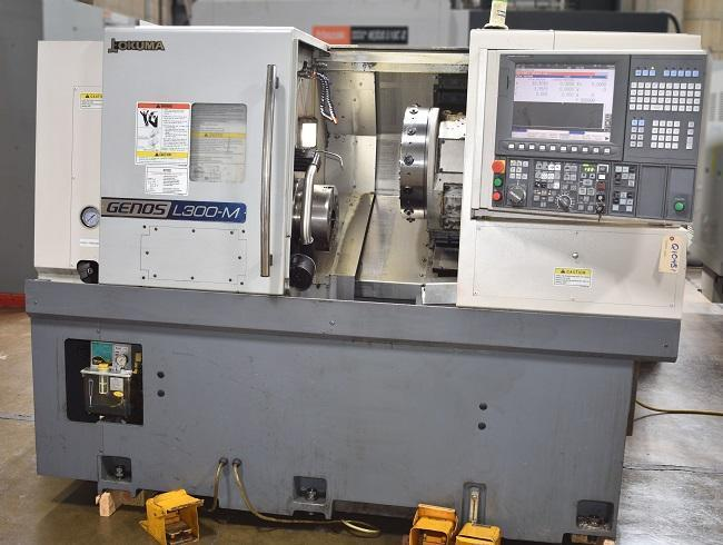 """OKUMA GENOS L300M, OSP-200 CNC Control, 10"""" Chuck, 20"""" Swing, 20"""" Centers with Programmable Tailstock, 3000 RPM Spindle, Live Tooling 4500 RPM, 3"""" Thru Hole, Chip Conveyor, New 2013."""