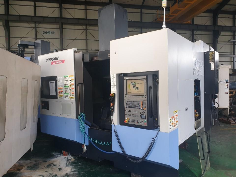 Doosan Model VC-630/5AX 5-Axis CNC Vertical Machining Center, New 2011