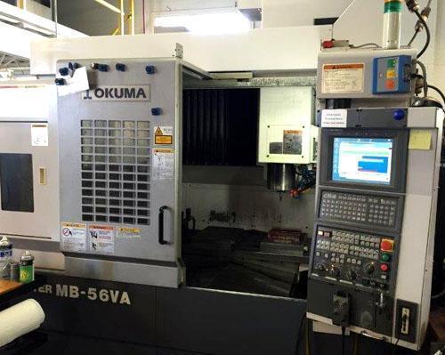 "OKUMA MB-56VA, OSP P-100 CNC, X=41"", Y=21"", Z=18"", CAT 40 Big Plus, 15,000 RPM, 32 ATC, 2005."