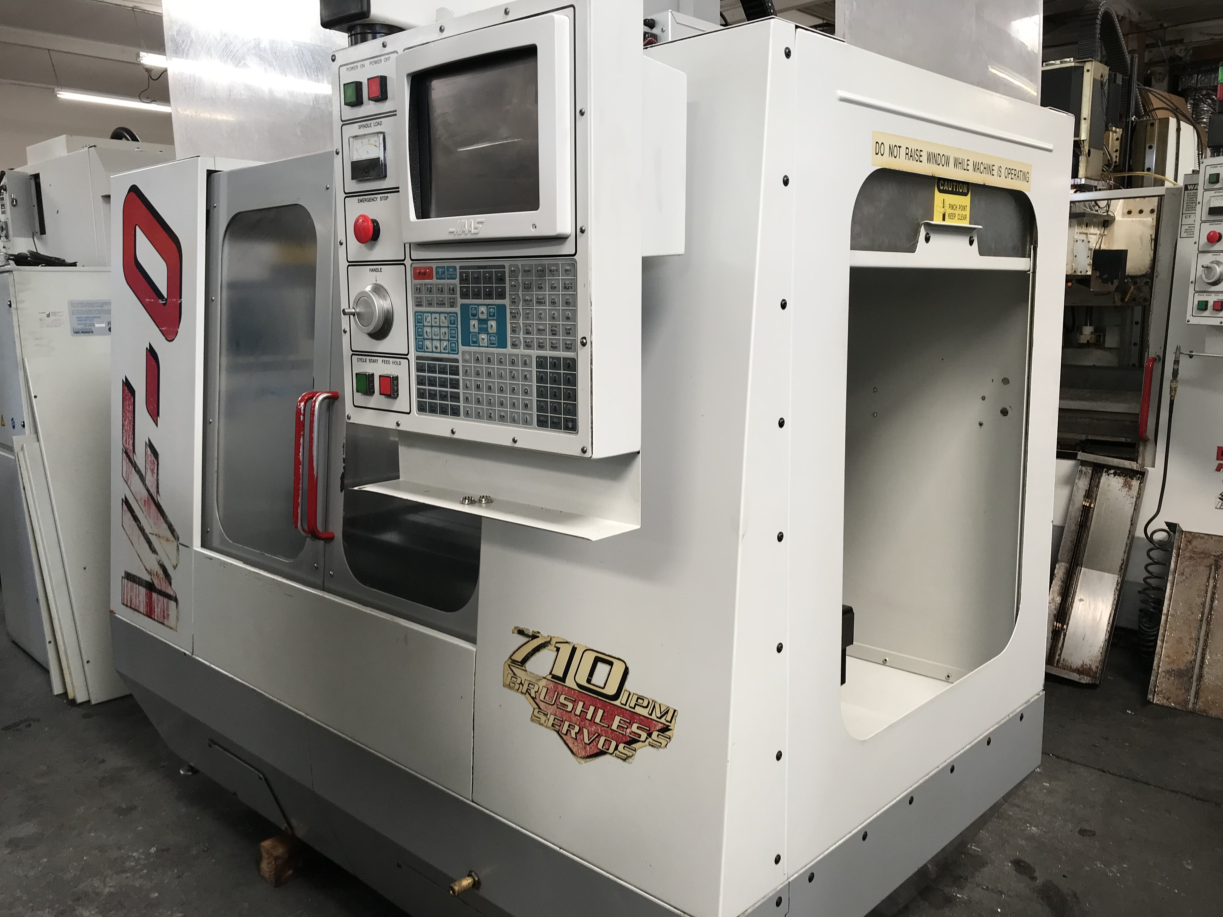 "Haas VF-0 VMC 1996, with: 20""x16""x20"" Travels, CT40 Taper, Brushless Servo, Chip Auger, and Coolant Tank."