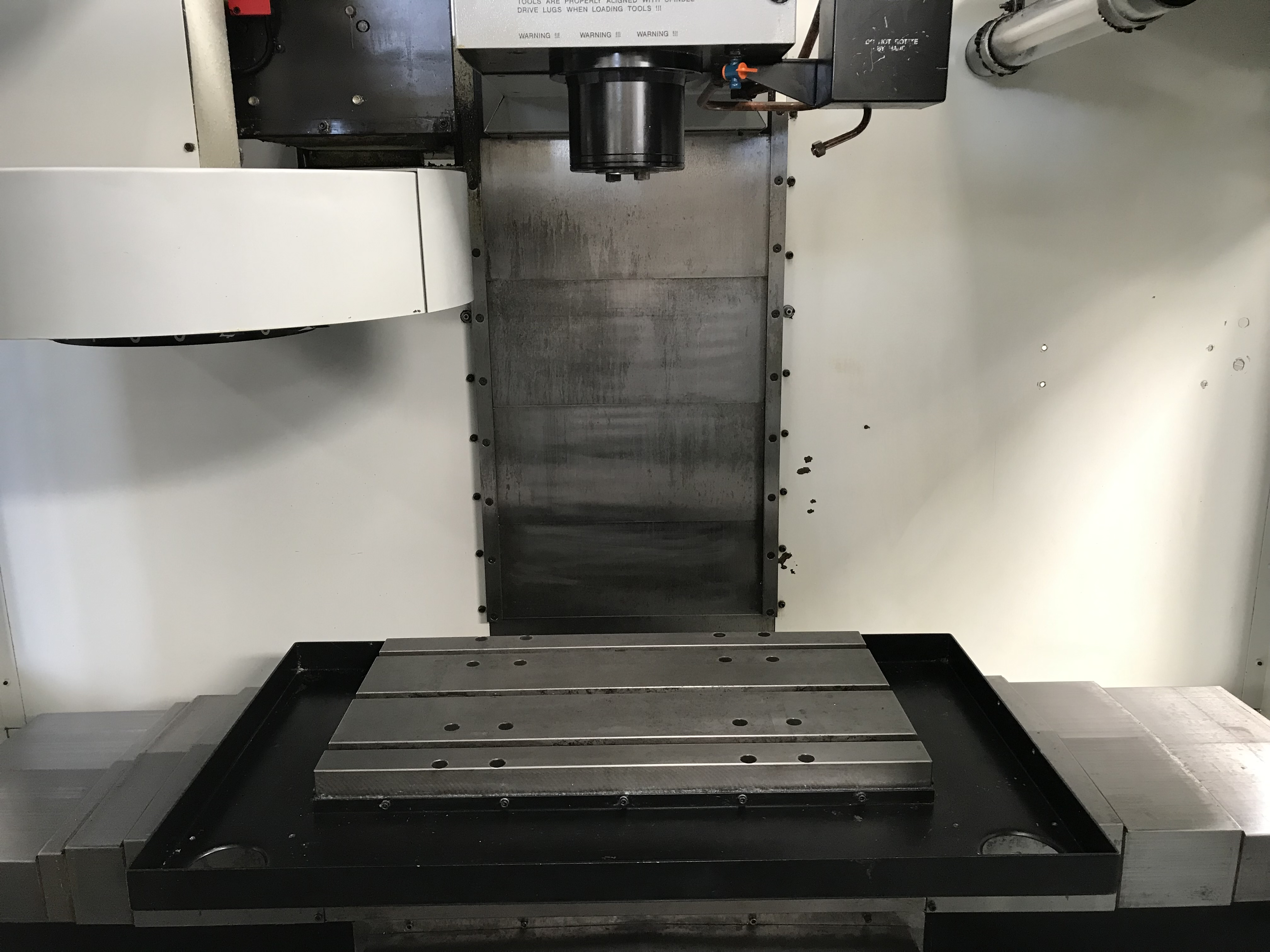 """Haas VF-0 VMC 1996, with: 20""""x16""""x20"""" Travels, CT40 Taper, Brushless Servo, Chip Auger, and Coolant Tank."""