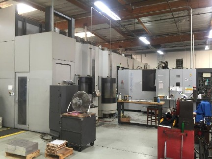 Toyoda FH550S FMS 2 Machine Cell System 2005 with: 24 Pallets, Fanuc 31i-A Control, (2) Load/Unload Stations, Double Stack, and TSC.