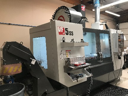 Haas VF-5SS VMC 2017 with: Haas Control, Renishaw WI Probe System, 40 Side Mount ATC, 15K RPM Thru Spindle Coolant, and Programmable Coolant.