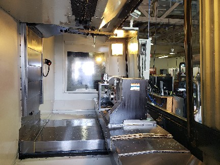 Haas VF-5/40TR VMC 2012, with: TR210 Trunnion Rotary, High Speed Machining, Prog. Coolant Nozzle, 750MB Memory, RJH, and Rigid Tap.