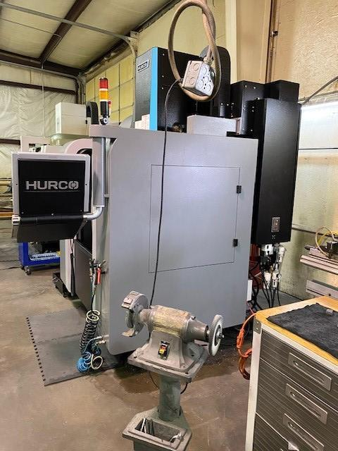 Hurco VM10Ui 5-Axis Trunnion Style VMC 2016 with: Hurco MAX5 CNC Control, Renishaw Part & Tool Probing Package, Rigid Tap, Side Mounted 20-Station Swing-Arm ATC, Chip Auger, Coolant Tank, and Spindle Thermal Chiller.