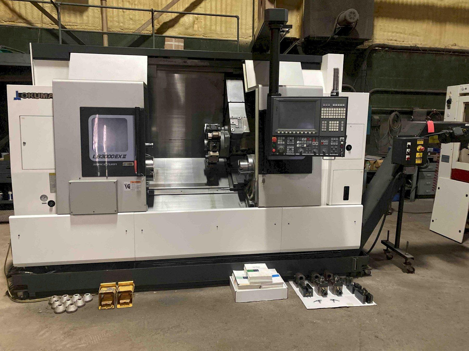 "Okuma LB3000EXII-MYW 6-Axis CNC Lathe (2014) , OSP300L, 10""/6"" Chucks, 32"" Centers, 3.58"" Bore, 3.25 Bar Capacity, 12 Position Turret, 30 HP, Live Holders, Static ID/OD Holders, Chip Conveyor, Low Hours (2014)"