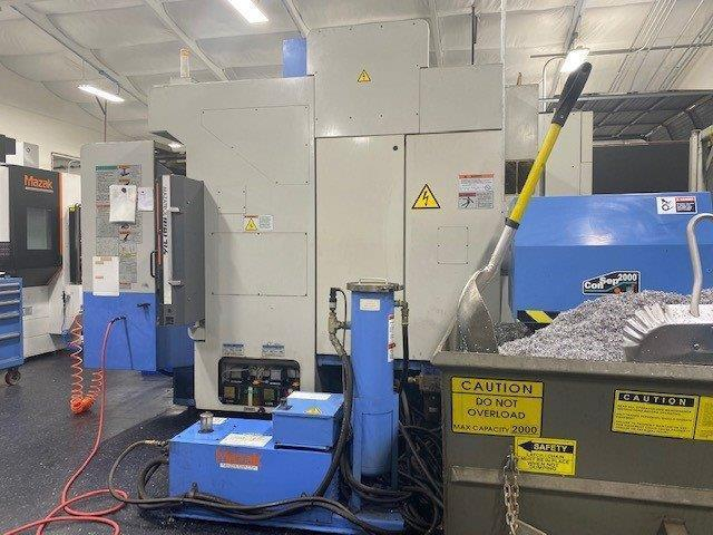 Mazak Variaxis 500-5XII 5-Axis VMC 2006 With: Mazatrol Matrix Voice Adviser CNC Control, Full 5-Axis, 2-Pallet Changer, Renishaw OMP40 Probe, 120-ATC, CAT-40 Taper, 12,000 RPM Spindle, Superflow 1000PSI Coolant Thru Spindle, Tool Tip Air Blast, and Mayfran Consep2000 Conveyor.