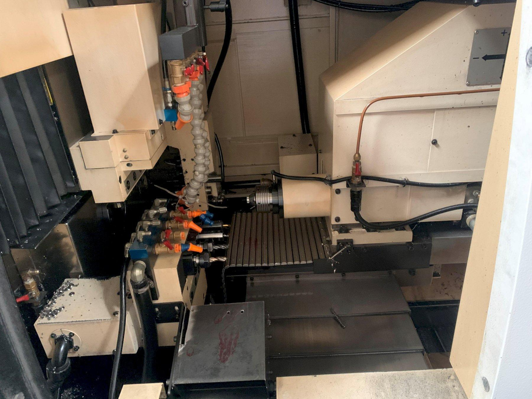Ganesh Cyclone 32CS CNC Swiss Lathe with: Edge Technologies Patriot 338 Bar Feeder, Mist Buster, and Parts Catcher.