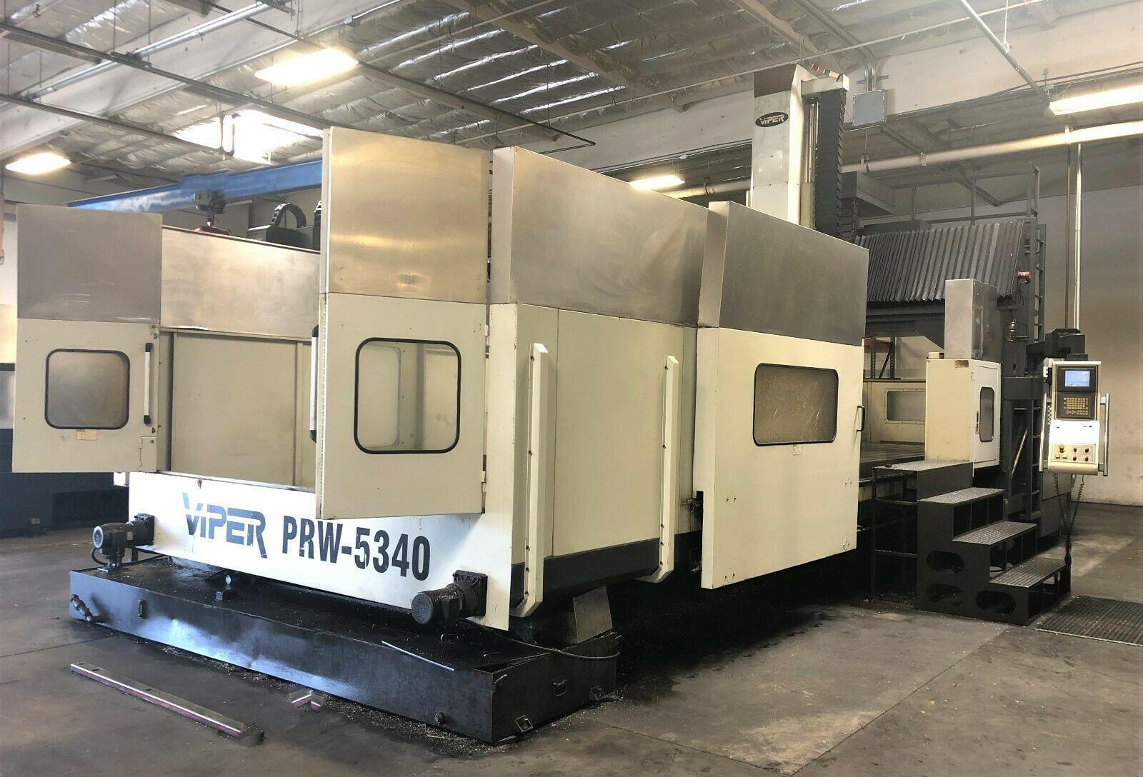 """MIGHTY VIPER PRW-5340 BRIDGE STYLE CNC VERTICAL MACHINING CENTER, Fanuc 21i CNC Control, 205"""" x 118"""" Table, X=200"""", Y=134"""", Z=42"""", 6000 Max Spindle RPM, 50 Taper, 60 ATC, New 2008."""