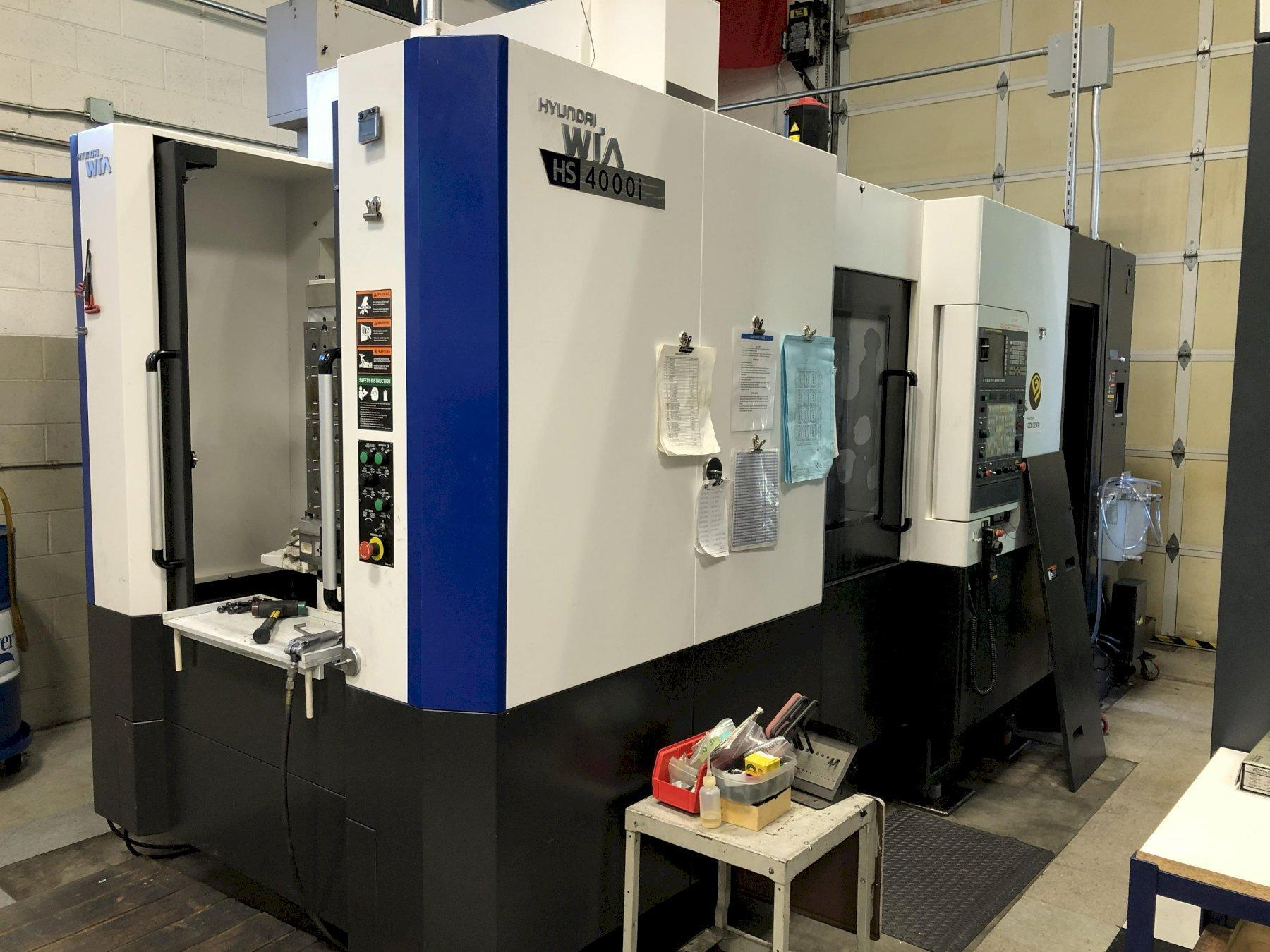 Hyundai Wia HS 4000i CNC HMC 2014 with Fanuc 31iA CNC Control, Full 4th Axis, Big Plus CAT 40 Spindle Taper, 80-ATC, High Pressure Coolant Thru Spindle, Remote MPG, Rigid Tapping, and Chip Conveyor.