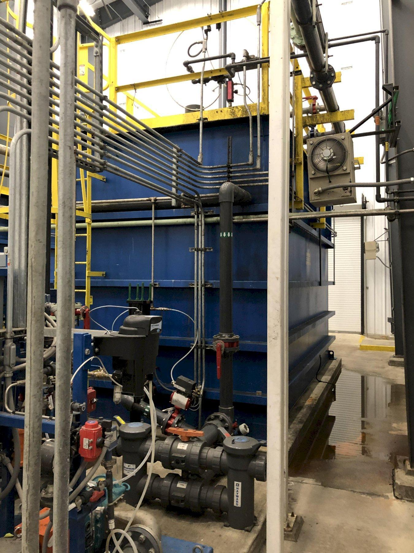 2016 GE water systems ultra FILTER system to include Lochinvar model 100148512 hot water heater, citric acid system with pumps and flow valves, sodium hypochlorite 12.5% system with pumps and flow valves, 2- 3 hp process pumps systems with remote controls and common plastic tank, 2- aerzen positive displacement delta blowers, 2- 8' x 17' x 11' tall lined tanks, 3- 1.5 hp recirculating pumps, 2- 2 way pendent controlled long lift electric hoists, all related piping and valves, mcc's, system controls with Allen Bradley compactlogixl43 plc, Allen Bradley flexu I/O