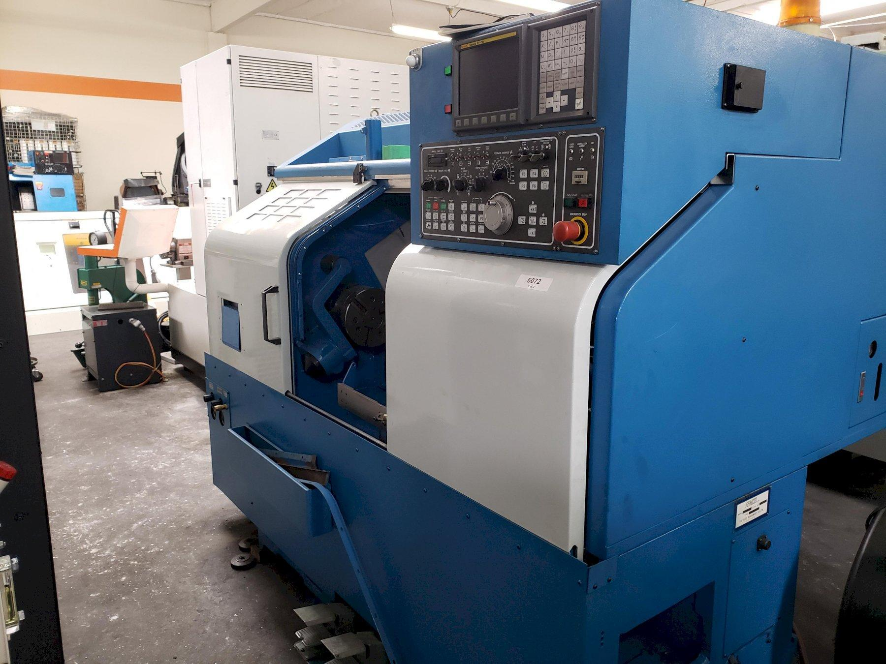 """Femco HL-25 CNC Lathe 2004, with Fanuc Oi-TB Control, 8"""" Chuck, Tool Presetter, Tailstock, and 12-Turret Chip Conveyor."""
