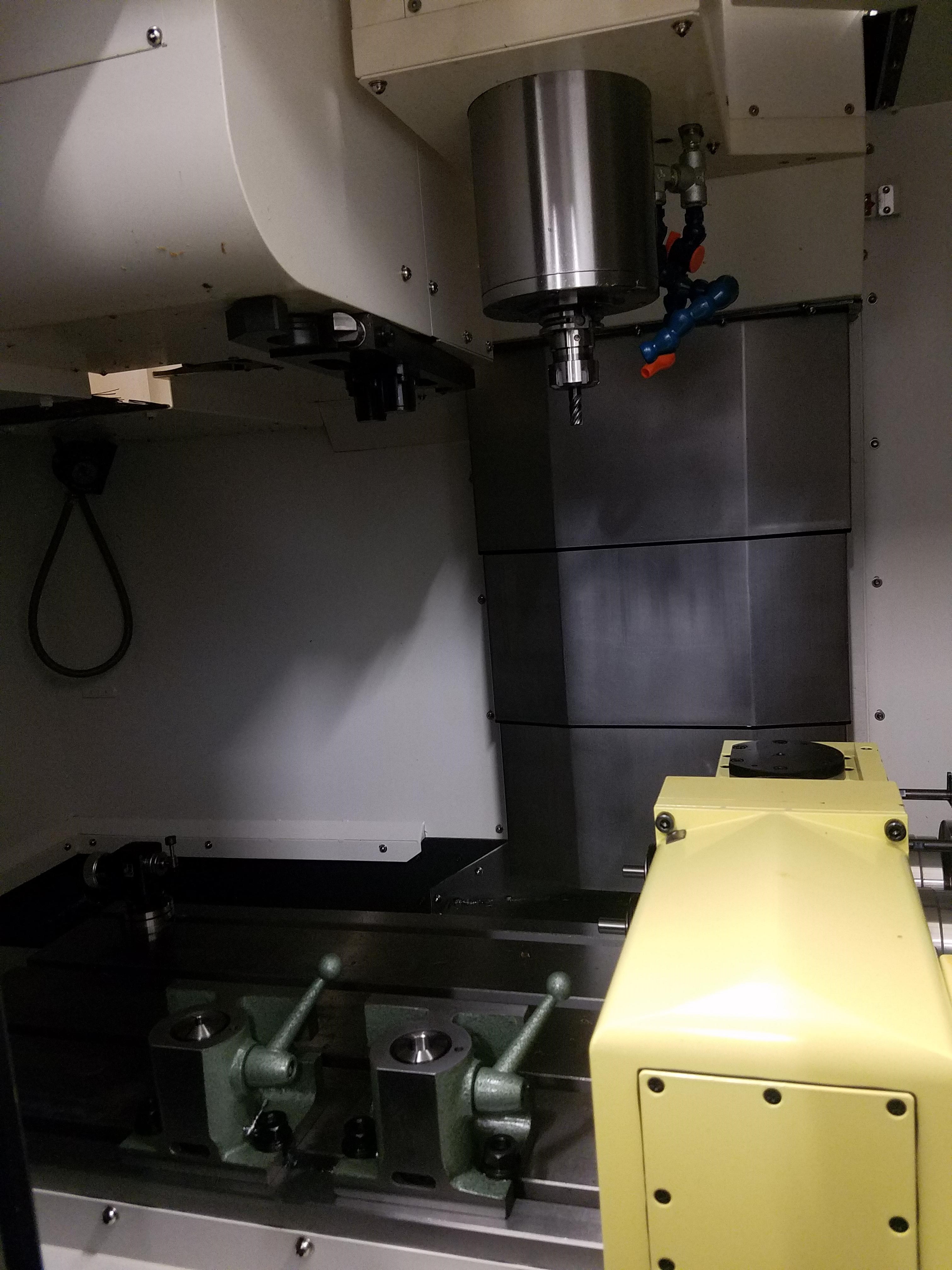 Hyundai Wia F400 3-axis twin 4th axis CNC Vertical Machining Center