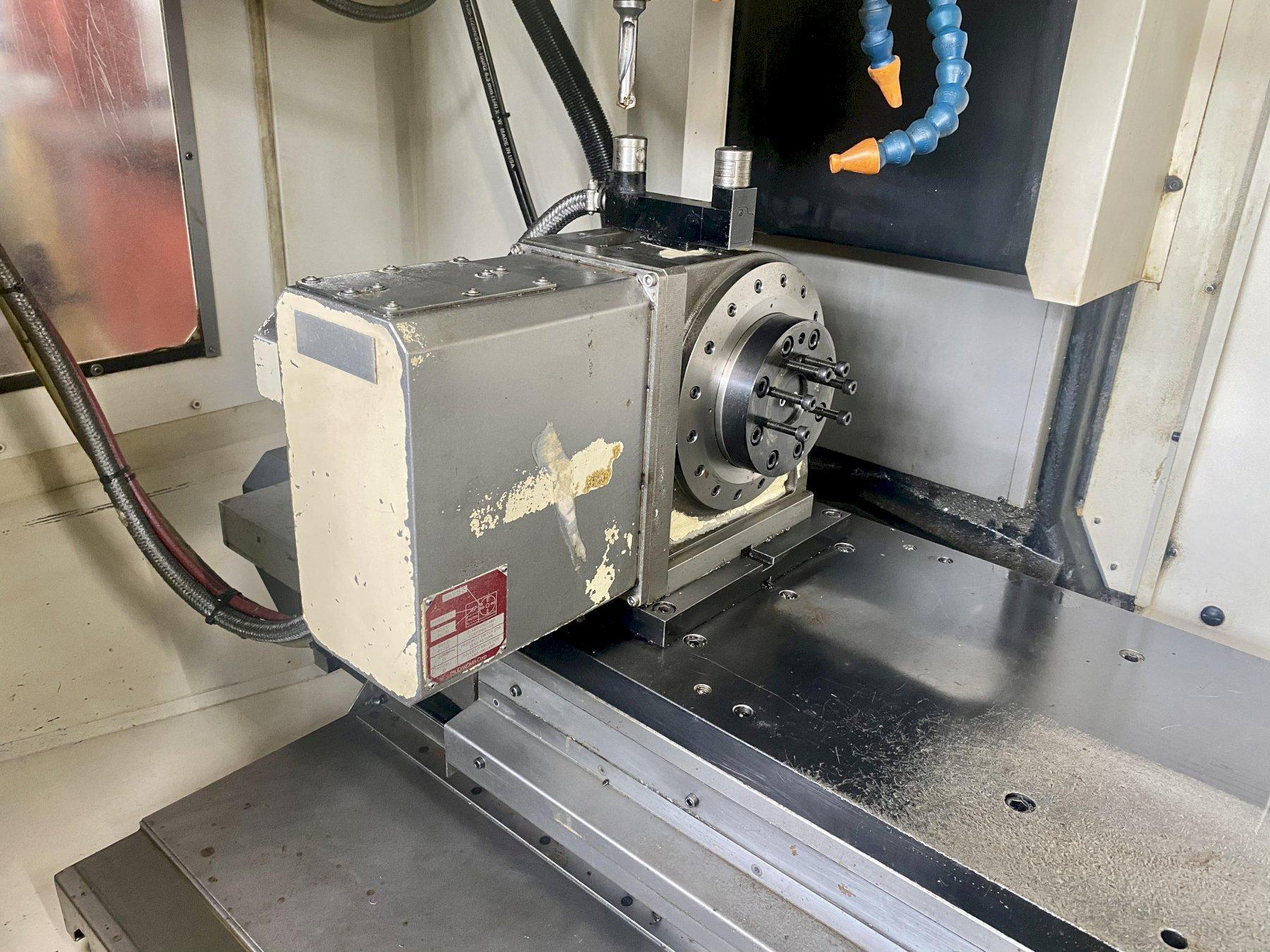 """FANUC ROBODRILL Alpha-T21iFLa 4-Axis CNC VERTICAL MACHINING CENTER, Fanuc 31i-A5 CNC Control, 33.46"""" x 16.1"""" Table, X=27.55"""", Y=15.74"""", Z=12.99"""", 10,000 Max Spindle RPM, BT-30 Taper, 21 ATC, TSC, Chip Conveyor, New 2010."""